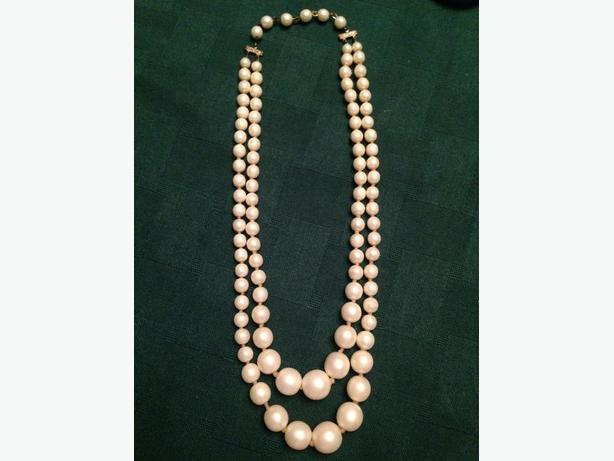Double strand of faux pearls