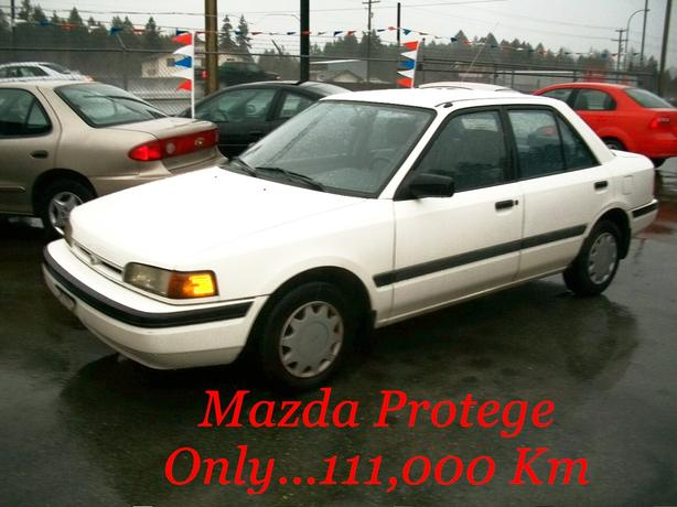 *** LOW, LOW KMS !!  MAZDA  PROTEGE  4-Door Sedan ....111,000  KMS !! ***