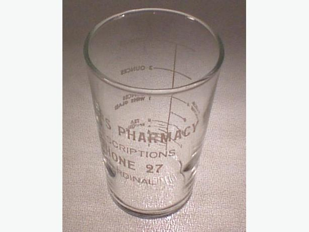 Baker's Pharmacy promotional beaker