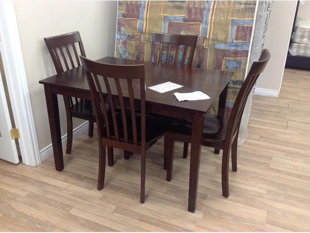 5 piece dining set..brand new...taxes in.