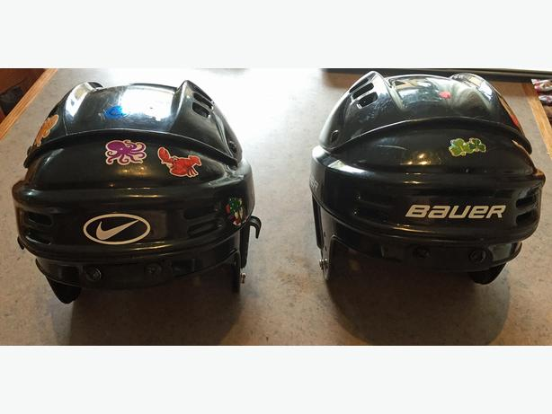 Two childrens size small hockey helmets