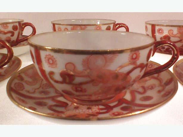 Porcelain demitasse cups and saucers