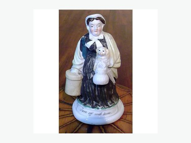 Antique Staffordshire bisque spill vase of a woman with dog