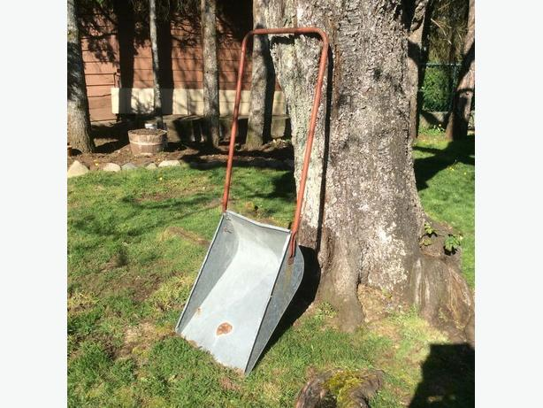 add to  your collection of galvanized garden art .. large shovel