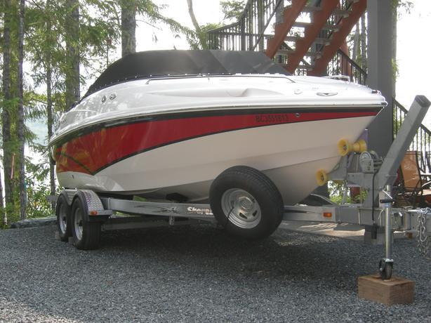 2011 Campion 645i SC & 2013 Shoreland' 5500lb. tandem axle roller-bunk trailer