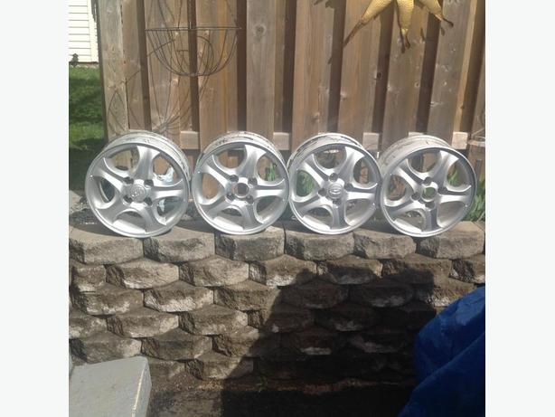 RIMS OFF A HYUNDAI-SIZE OF RIMS ARE 15 INCH-GOOD CONDITION