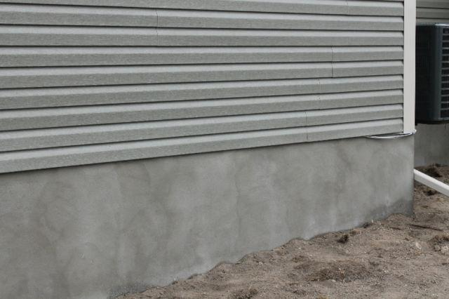 Foundation parging stucco masonry repair outside ottawa for Concrete block stucco