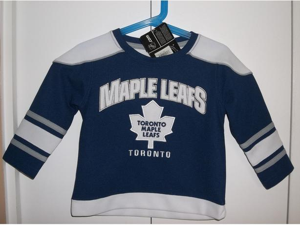 """BRAND NEW "" JERSEY AND GENTLY USED SLEEPER WITH MAPLE LEAF LOGO"