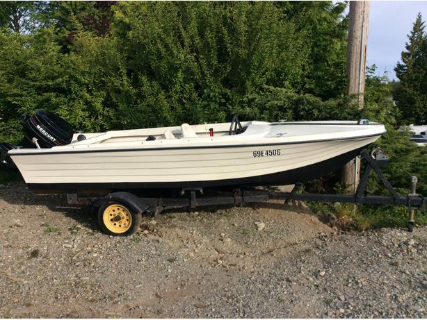 Fiberglass 14 foot boat,motor,trailer.