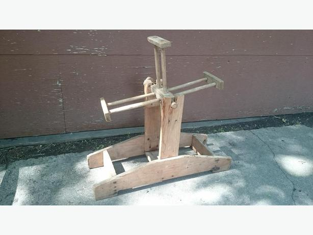 Antique yarn winder spool on stand