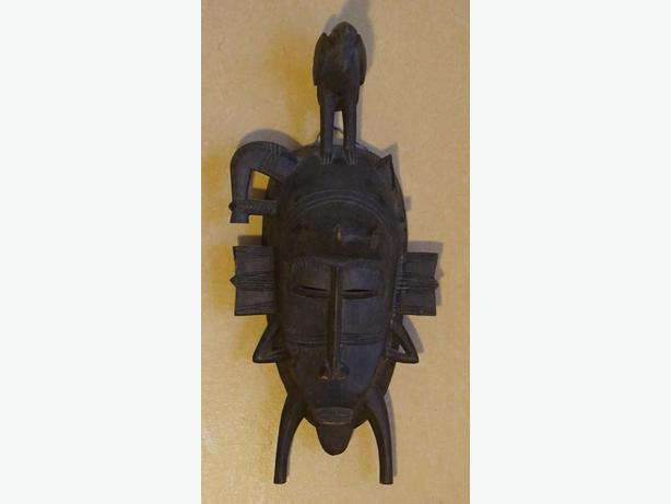 4U2C AFRICAN CARVED WOOD TRIBAL MASK WITH BIRD ON HEAD.