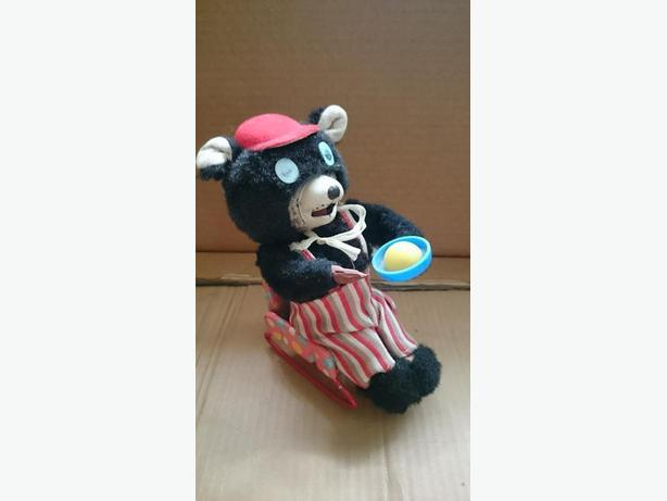 Japanese wind up toy..Bear in rocking chair eating porridge