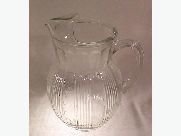 Ribbed glass pitcher with ice lip