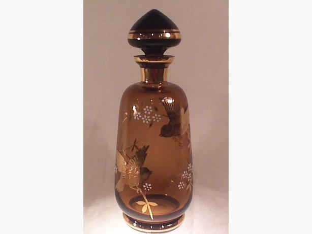 Glass decanter with gold birds