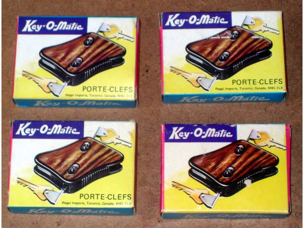 4 New, Never Used, Still in their Boxes, Key-O-Matic Key Holders