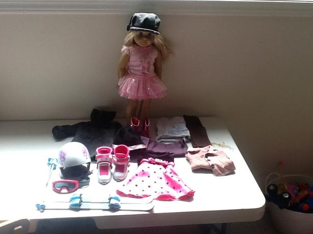 "American girl ""Clair"" doll and out fits plus a box of new ski gear"