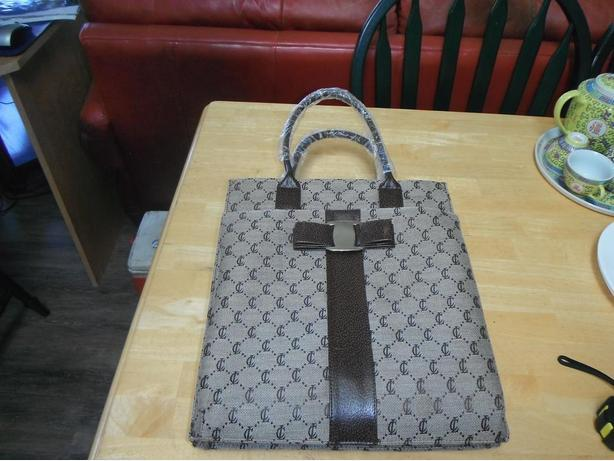 brand new still has wrap on it, 7 zipper purse