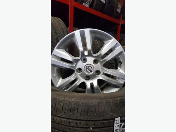 "16"" OEM Nissan wheels"
