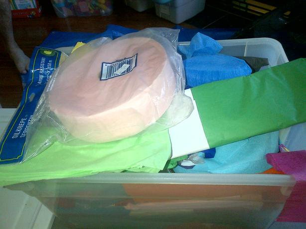 Box of tissue paper and streamers