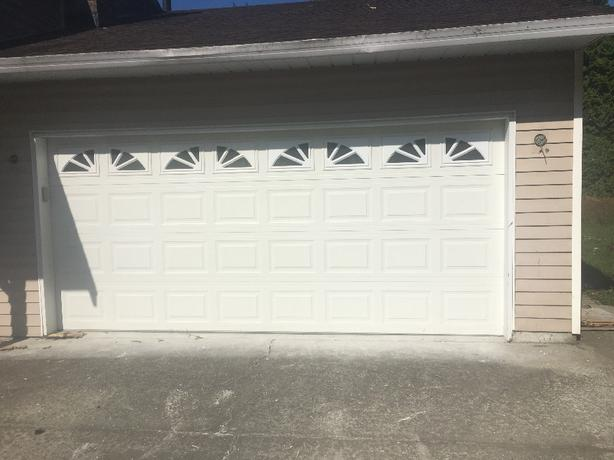 16 ft x 7 ft garage door with windows and 1/2 hp opener.