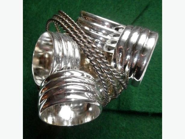 Set of 8 Silverplate napkin rings and 1 silverplate filigree basket