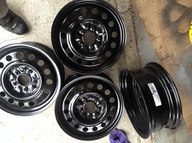 "SET OF BRAND NEW 16"" STEEL WHEELS"