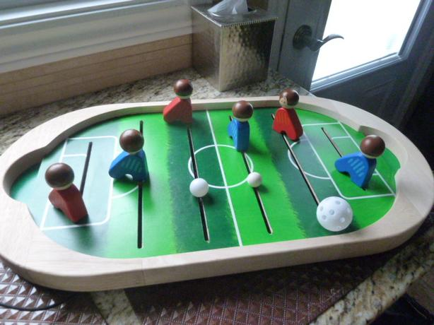 Wooden Soccer game with different size soccer balls