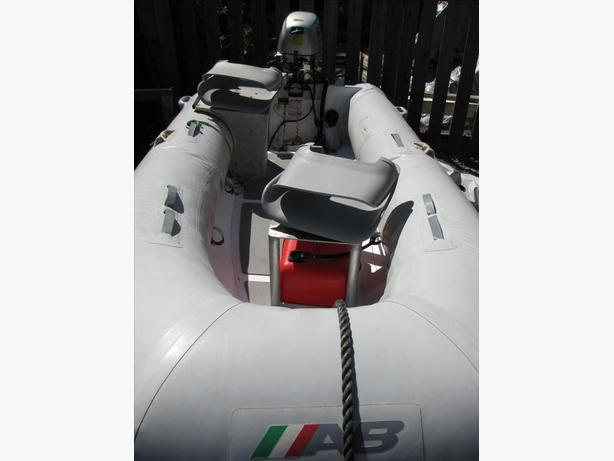 AB Ridgid Hull Inflatable with 20 hp honda 4 stroke outboard