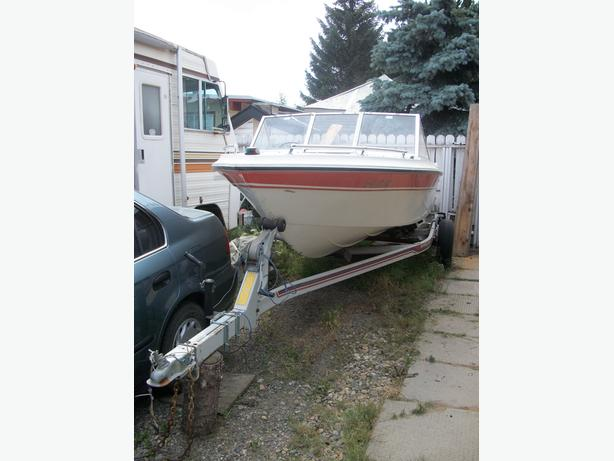 16.5 Vanguard motor boat and trailer
