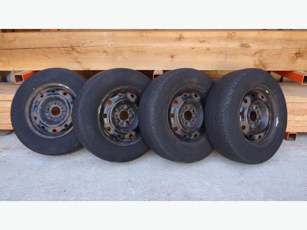 Four All-Season Tires on Rims - 215/70R15