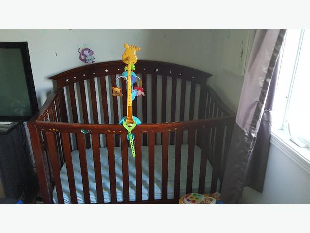 crib matress and music toy