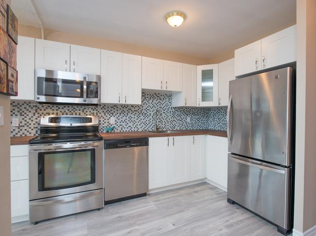 COMPLETELY RENOVATED 3 BED, 1.5 BATH CONDO IN BEACON HILL SOUTH!