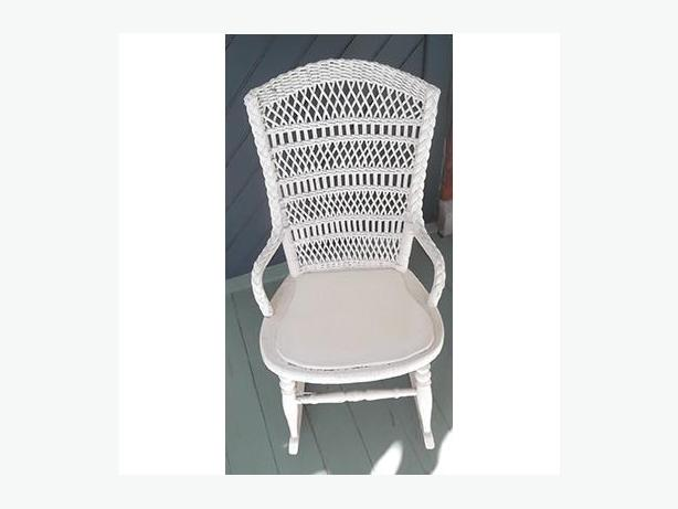 Antique white rattan rocking chair