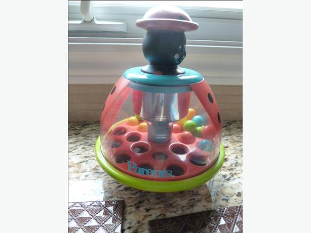 Lady Bug spinning top by Parents