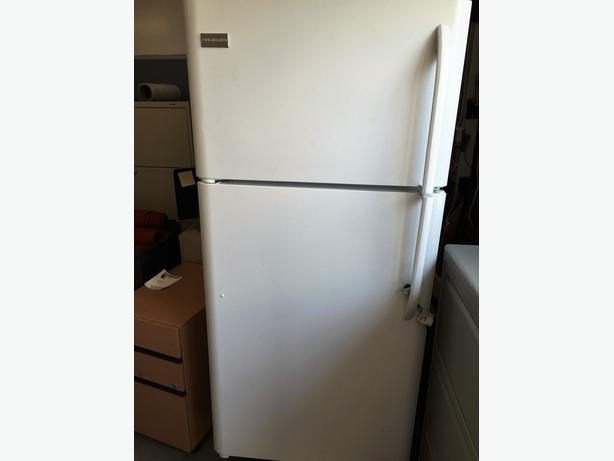 Frigidaire Refrigerator / Freezer. All glass shelves. Used for 4 months