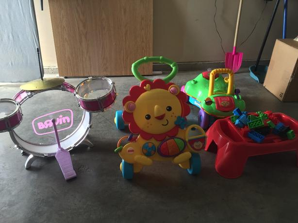 assorted toys and baby's tub