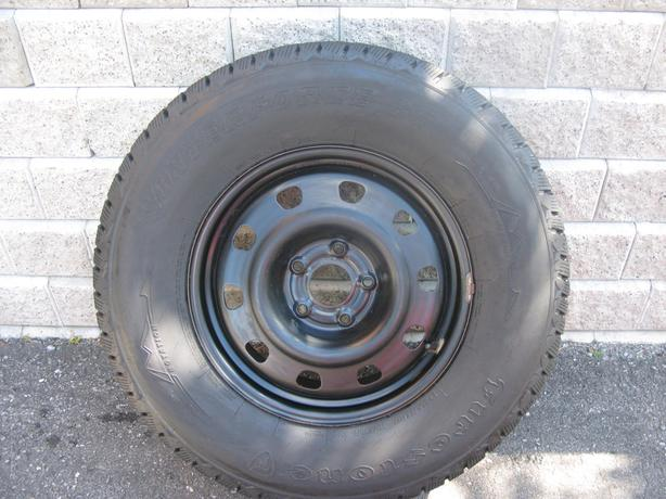 FOUR (4) FIRESTONE WINTERFORCE LT TIRES W/RIMS /LT255/75/17/ - $750