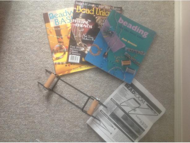 Bead loom and books.