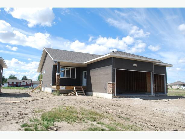 "1302 sqft, triple garage bungalow in Bethune's ""Urban Fringe Subdivision"""