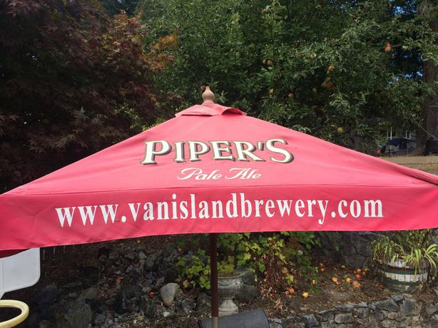 Red wooden parasol Vancouver Island Brewery