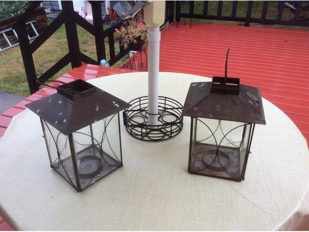 two weathered outdoor candle lanterns
