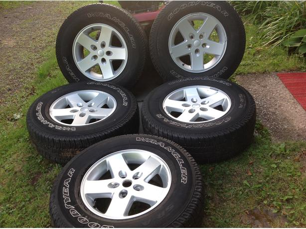 WRANGLER RIMS AND TIRES sell or trade