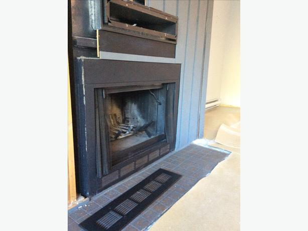 wood burning fireplace with accessories saanich