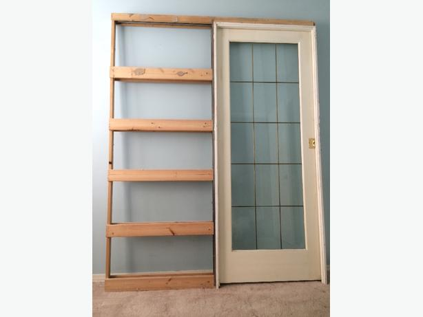 "Reduced to sell standard size 32"" glass and brass pocket door"