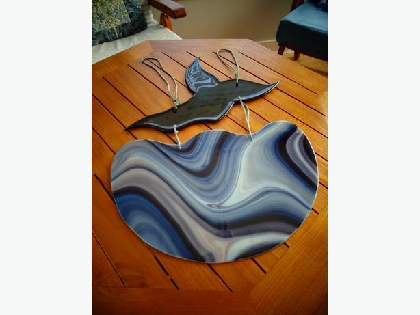 Glass whale in ocean