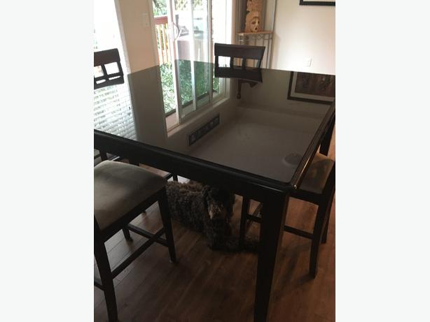 table with glass top and chairs