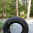 Brand new Goodyear white lettered tire 225-75-16