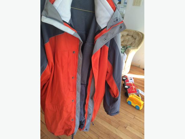 Orange and gray hooded Columbia winter ski jacket