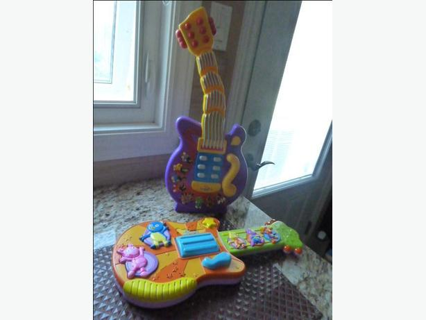 Wiggles Dancing Guitar and Les Melodilous Guitar