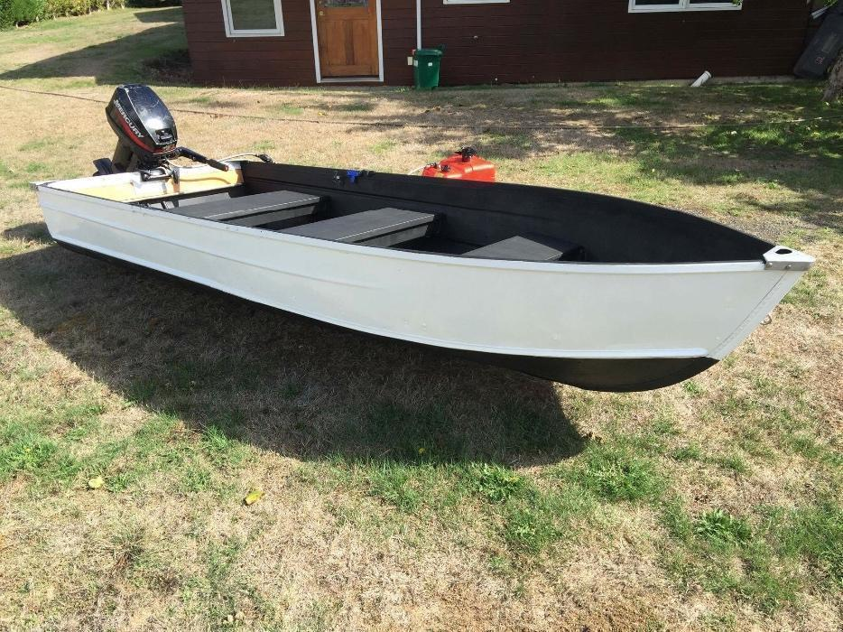 awesome 12 foot aluminum boat with 15hp motor outside